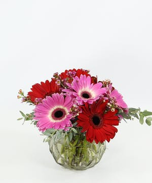 Flower Power!  A bright mix of gerbera daisies and accents in a faceted glass bowl.