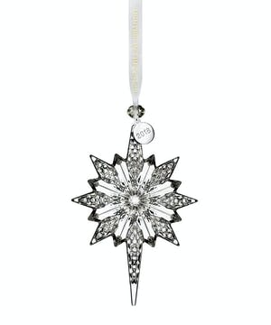 this Snowstar Ornament effortlessly sparkles. Elegantly strung with a satin Waterford ribbon accented with diamond shaped glass bead and silver dated tag