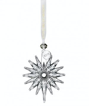 This Snow Crystal Ornament radiates beauty. Elegantly strung with a satin Waterford Lighting Up The Season ribbon accented with diamond shaped glass bead and silver dated tag.