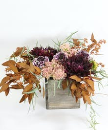 Celebrate Fall with this wooden box overflowing with dahlias, sedum and scabiosa with accents of tinted and willow eucalyptus.
