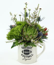 Send this Fantasy Football Legend mug to any football fan.  It features a succulent, mini ying yang daisies and accents of eryngium, hypericum and calcynia.